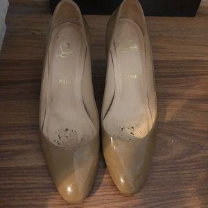Christian Louboutin tan patent heels.